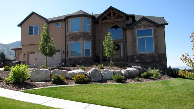 Dream home surrounded by professionally installed landscape