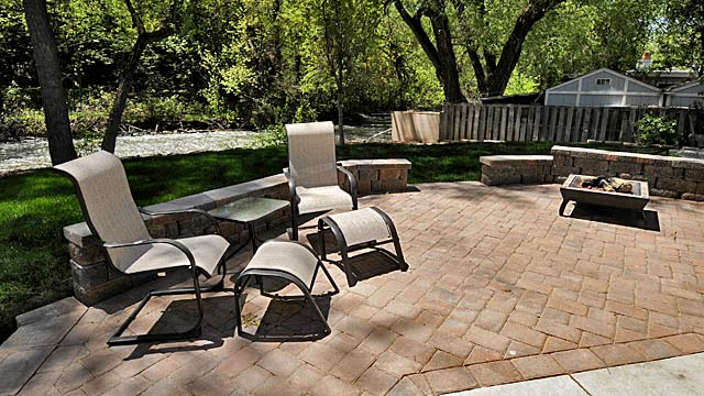 Paver patio with sitting wall and fireplace